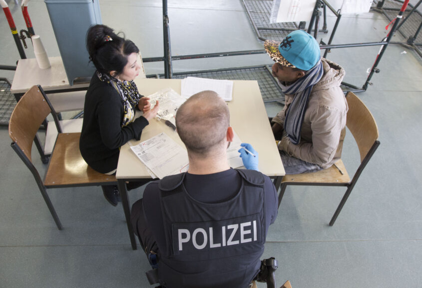Rosenheim, 05.02.2016  - A refugee is questioned by the police.