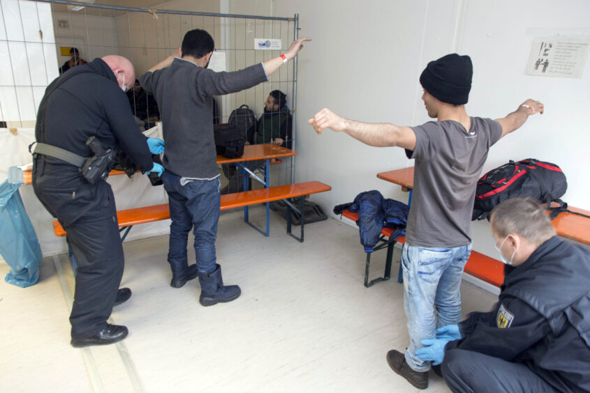 Rosenheim, 05.02.2016  - Refugees are checked  at a police station in Rosenheim.