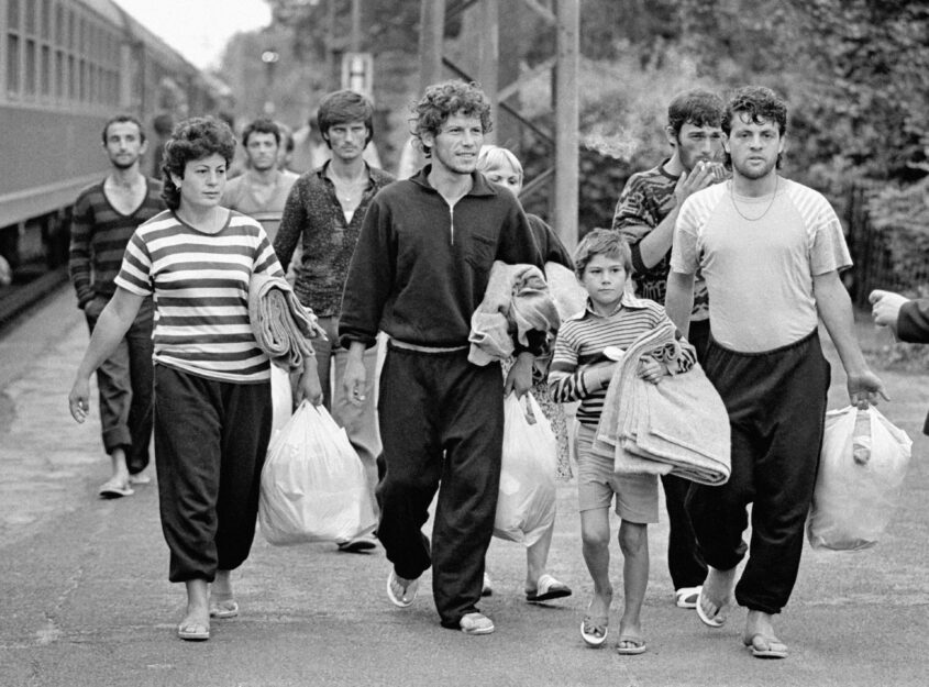 Geseke, 15.07.1990 -  Albanian refugese arrive in Geseke, Germany. More than 3,000 Albanian nationals fled the communist regime of Albania in the German Embassy Tirana and were later allowed to travel to Germany as embassy refugees.